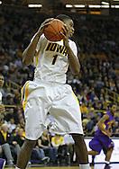 December 07 2010: Iowa Hawkeyes forward Melsahn Basabe (1) pulls down a rebound during the first half of their NCAA basketball game at Carver-Hawkeye Arena in Iowa City, Iowa on December 7, 2010. Iowa defeated Northern Iowa 51-39.