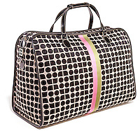 Kate Spade luggage bag on white background