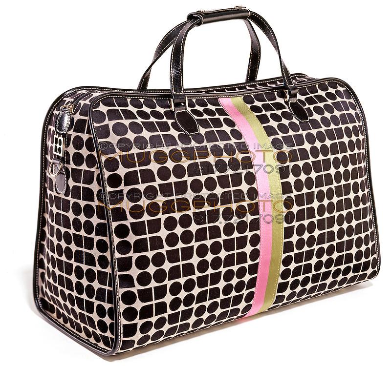 Kate Spade luggage bag on white background
