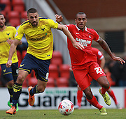Oxford midfielder Liam Sercombe & Leyton Orient striker Jay Simpson battle for possession during the Sky Bet League 2 match between Leyton Orient and Oxford United at the Matchroom Stadium, London, England on 17 October 2015. Photo by Bennett Dean.