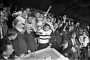 31/05/1964<br /> 05/31/1964<br /> 31 May 1964<br /> Presentation of Bradmola Cup at Tolka Park, Dublin. Grange United defeated Cherry Orchard 2-0. Picture shows Joe Clark, the Grange Captain, raising aloft the Bradmola Cup after he received it from Mr. Charlie Liddy, Chairman A.U.L. Included are members of the team, Mr. Jim Younger, Honorary Secretary A.U.L and Mr. Sean Monahan, Honorary Secretary Grange United.