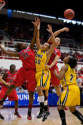 March 20, 2010; Stanford, CA, USA; Rutgers Scarlet Knights guard/forward April Sykes (12) and forward Myia McCurdy (24) keep a loose ball from Iowa Hawkeyes forward Gabby Machado (50) during the first half in the first round of the 2010 NCAA womens basketball tournament at Maples Pavilion. Iowa defeated Rutgers 70-63.