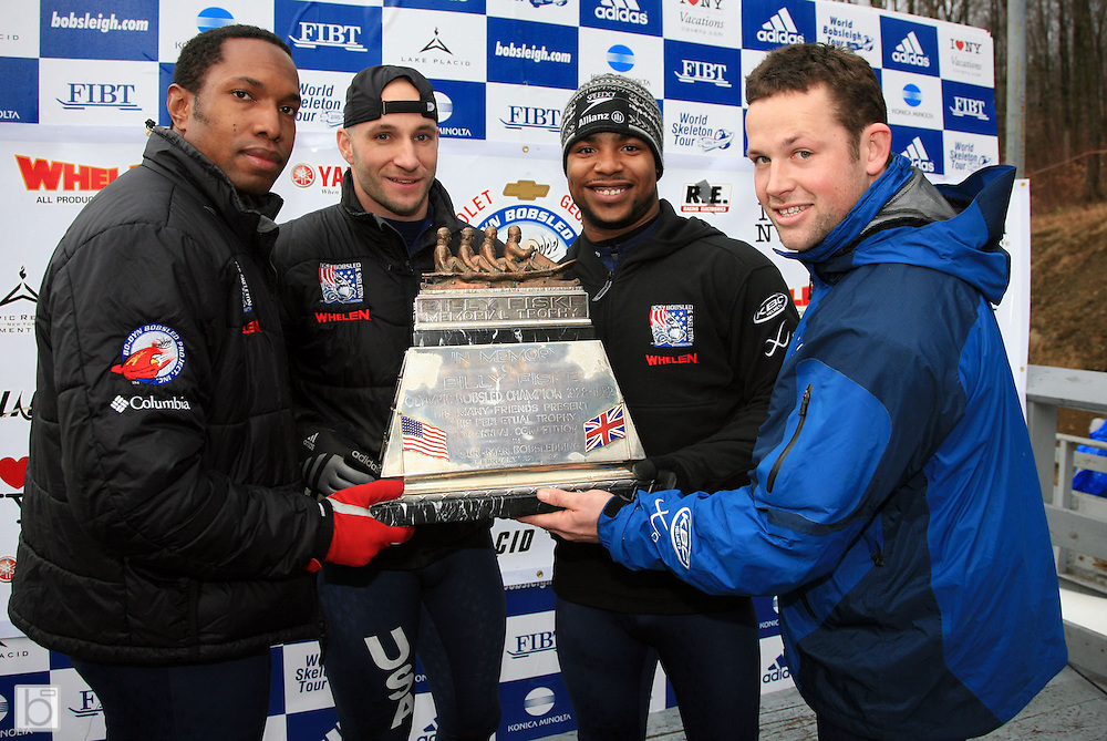 4-man Bobsled Pilot Grayson Fertig (on right) poses with his team of (from left) pushers Will Person and Brian Spickler and brakeman Theron Johnson with the Billy Fisk Memorial Trophy awarded to the 4-man Bobsled National Champions after winning the event at the Olympic Sports Complex in Lake Placid, N.Y. on Saturday, January 6 2007.<br />
