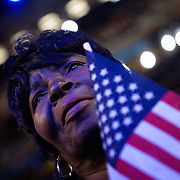 Margie Woods listens as Michelle Obama speaks on the first day of the Democratic National Committee (DNC) Convention at the Pepsi Center in Denver, Colorado (CO) Monday, Aug. 25, 2008.  ..Photo by Khue Bui