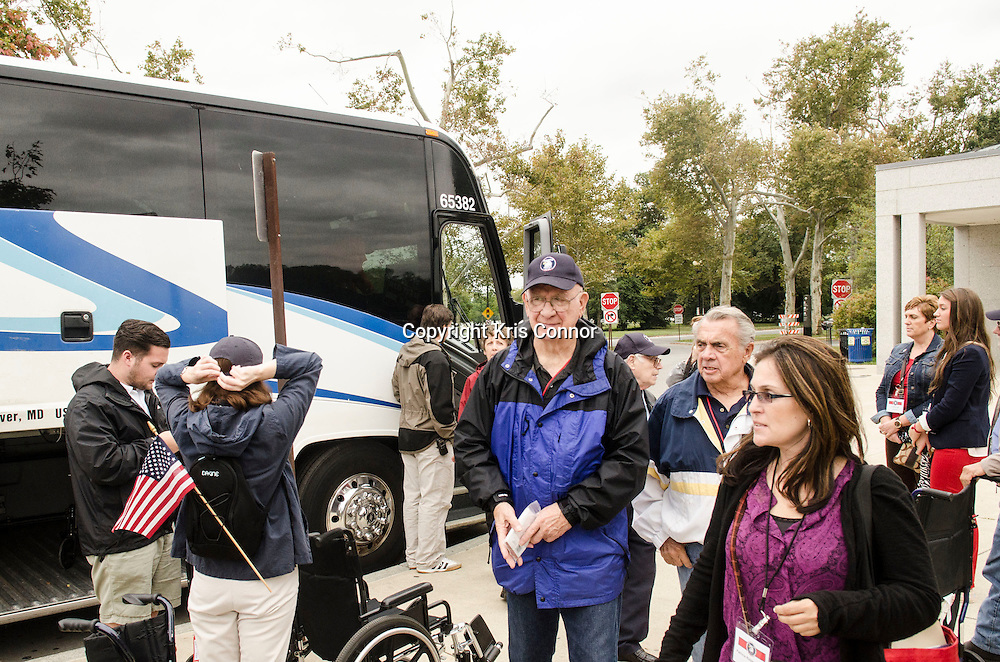 A group of veterans and their family members from the Honor Air Knoxville organization visit the closed World War Two Memorial in Washington DC on October 9, 2013. The memorial has been closed due to the Federal Shut Down. Photo by Kris Connor.