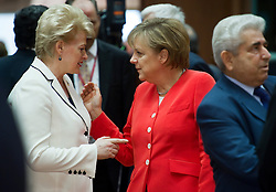 Angela Merkel, Germany's chancellor, right, speaks with Dalia Grybauskaite, Lithuania's president,  during the European Summit meeting at EU Council headquarters in Brussels, Belgium, on Thursday, June 17, 2010. (Photo © Jock Fistick)