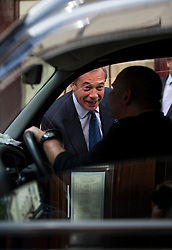 © Licensed to London News Pictures. 15/05/2015.  UKIP leader NIGEL FARAGE talking to a taxi driver  while leaving Hertford Street Members Club in Mayfair, London with party donors Alan Bown and Aaron Banks on May 15, 2015. Farage has been critiqued by members of the UKIP party after a u-turn on his decision to stand down as leader. Photo credit: Ben Cawthra/LNP