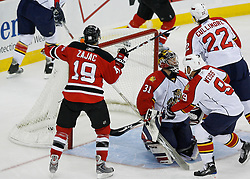 Feb 28, 2009; Newark, NJ, USA; New Jersey Devils center Travis Zajac (19) celebrates a goal by New Jersey Devils left wing Zach Parise (9) during the first period at the Prudential Center.