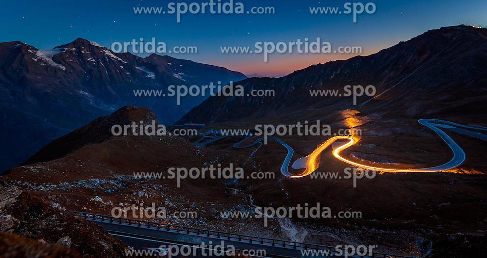 THEMENBILD - ein Auto fährt vor Sonnenaufgang durch die Serpentinen, Langzeitbelichtung. Die Grossglockner Hochalpenstrasse verbindet die beiden Bundeslaender Salzburg und Kaernten mit einer Laenge von 48 Kilometer und ist als Erlebnisstrasse vorrangig von touristischer Bedeutung, aufgenommen am 15. September 2016, Bruck a. d. Glocknerstrasse, Oesterreich // a car drives before sunrise through the serpentine, Long Exposure. The Grossglockner High Alpine Road connects the two provinces of Salzburg and Carinthia with a length of 48 km and is as an adventure road priority of tourist interest at Bruck a. d. Glocknerstrasse, Austria on 2016/09/15. EXPA Pictures © 2016, PhotoCredit: EXPA/ JFK
