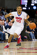 DALLAS, TX - NOVEMBER 25: Ben Moore #00 of the SMU Mustangs brings the ball up court against the Arkansas Razorbacks on November 25, 2014 at Moody Coliseum in Dallas, Texas.  (Photo by Cooper Neill/Getty Images) *** Local Caption *** Ben Moore