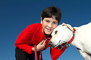 Boy with dog, Modiin, Israel. Photography by Debbie Zimelman, Modiin, Israel. Bar Mitzvah invitation photograph.