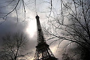 Paris January 29, 2007 -  The Eiffel Tower is an iron tower built on the Champ de Mars beside the River Seine. It is the tallest structure in Paris and possibly the most recognized monument in the world. Named after its designer, engineer Gustave Eiffel, it is the most visited monument in the world REPORTERS©Jean-Michel Clajot