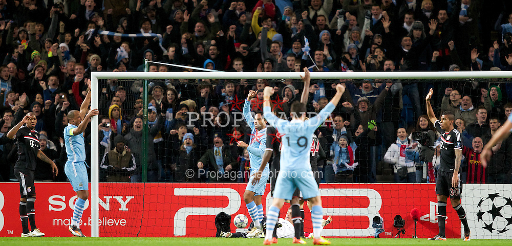 MANCHESTER, ENGLAND - Wednesday, December 7, 2011: Manchester City's Joleon Lescott beats FC Bayern Munchen's goalkeeper and captain Jorg Butt in the air to score the opening goal but the goal was disallowed by the referee during the UEFA Champions League Group A match at the City of Manchester Stadium. (Pic by Vegard Grott/Propaganda)