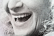 extreme mouth close up from a newspaper print with halftone print dots