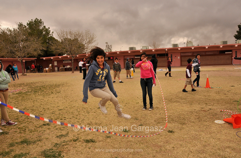 Elvira Elementary School 5th-grader, Lydia Nunez, 11, (center), participates in Jump Rope For Heart, a fundraising and fitness program, during Wellness Week in Tucson, Arizona, USA, on February 14th, 2012, the date of the 100th birthday of the state of Arizona.