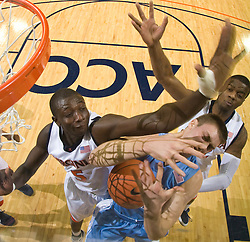 Virginia center Assane Sene (5) fouls North Carolina forward Tyler Hansbrough (50).  The the #5 ranked North Carolina Tar Heels defeated the Virginia Cavaliers 83-61 in NCAA Basketball at the John Paul Jones Arena on the Grounds of the University of Virginia in Charlottesville, VA on January 15, 2009.