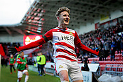 Doncaster Rovers midfielder Kieran Sadlier (22) celebrates making it 3-1 to Doncaster during the EFL Sky Bet League 1 match between Doncaster Rovers and Peterborough United at the Keepmoat Stadium, Doncaster, England on 9 February 2019.