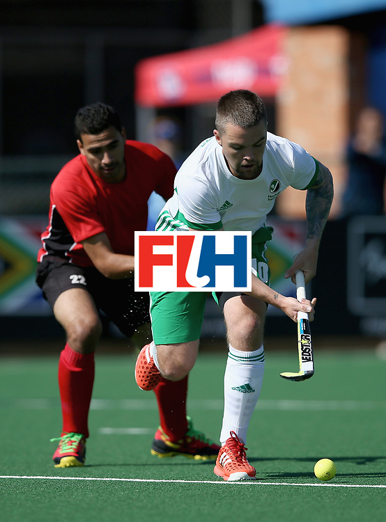 JOHANNESBURG, SOUTH AFRICA - JULY 13:  Alan Sothern of Ireland and Mohamed Ragab of Egypt battle for possession during day 3 of the FIH Hockey World League Semi Finals Pool B match between Ireland and Egypt at Wits University on July 13, 2017 in Johannesburg, South Africa.  (Photo by Jan Kruger/Getty Images for FIH)