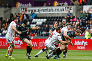 Ospreys outside half Dan Biggar is tackled by the Ulster defence during the Guinness Pro 12 2017 Round 21 match between Ospreys and Ulster at the Liberty Stadium, Swansea, Wales on 29 April 2017. Photo by Andrew Lewis.