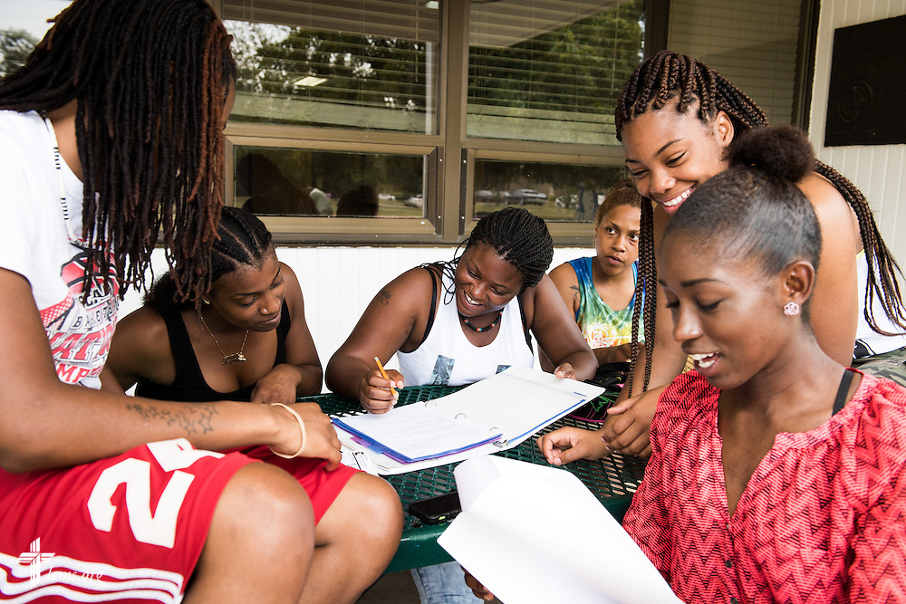 Friends and students (L-R) La'Shay Lettingham, Keegan Snowden, Michelle Fountain, Christy Ducre, Sherrese Moore, and Desiree Wilson gather to study on the campus of Concordia College Alabama on Wednesday, August 20, 2014, in Selma, Ala.  LCMS Communications/Erik M. Lunsford