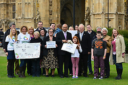 © Licensed to London News Pictures. 14/05/2013. Westminster, UK Keith Vaz MP (centre) receives the petition. Patients campaigning for a life-saving treatment to be made available for all sufferers of the rare blood disease atypical Haemolytic Uraemic Syndrome (aHUS) present an urgent petition with over 30,000 signatures to MPs at the House of Commons on Tuesday May 14 2013... Photo credit : Stephen Simpson/LNP