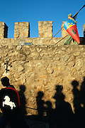 SPAIN / Castile-La Mancha / Toledo province / Consuegra.  Medieval recreations in Spain. Every August the village recreates a battle of 1097 between the Castilian and Leonese army of Alfonso VI and the Almoravids. Soldiers in the walls of the castle.....