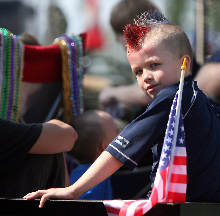 BRENDAN FITTERER |  Times.PT_340691_FITT_lutz_4 (07/04/2011) With a red, white and blue mohawk for the occasion, Seth Simmering waits to ride the parade route in the Lutz Independence Day Parade Monday..BRENDAN FITTERER |  Times.