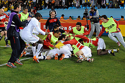 June 23, 2010; Pretoria, SOUTH AFRICA; USA midfielder Landon Donovan (10) celebrates with teammates after scoring the winning goal in stoppage time against Algeria during Group C play in the 2010 World Cup at Loftus Versfeld Stadium.