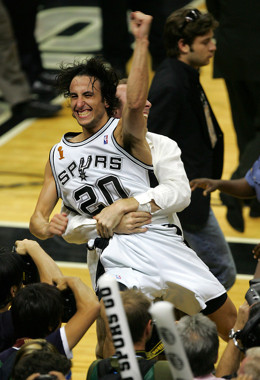 Spurs guard Manu Ginobili celebrates the Spurs NBA Championship after their game seven, 81-74 win over the Pistons in the NBA Finals at the SBC Center in San Antonio Thursday June 23, 2005 .