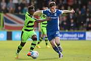 Forest Green Rovers midfielder Drissa Traore (4) and North Ferriby United forward Reece Thompson (25) battle for possession 0-0 during the Vanarama National League match between Forest Green Rovers and North Ferriby United at the New Lawn, Forest Green, United Kingdom on 1 April 2017. Photo by Alan Franklin.