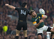 Twickenham. Great Britain, right, fullback, Willie LE ROUX, shields the ball from Nehe MILNER-SKUDDER,  during, Semi Final. South Africa vs New Zealand  2015 Rugby World Cup,  Venue, Twickenham Stadium, Surrey England.   Saturday  24/10/2015.   [Mandatory Credit; Peter Spurrier/Intersport-images]