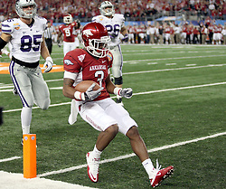 Arkansas wide receiver Joe Adams (3) crosses the goal line after returning a punt for a touchdown during the 2012 AT&T Cotton Bowl game between Arkansas and Kansas State at Cowboy Stadium in Arlington, Tx