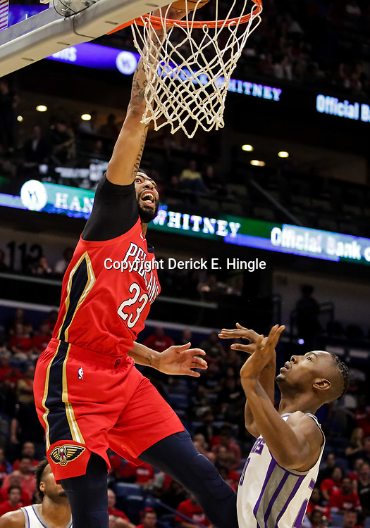 Oct 19, 2018; New Orleans, LA, USA; New Orleans Pelicans forward Anthony Davis (23) dunks over Sacramento Kings forward Harry Giles (20) during the first quarter at the Smoothie King Center. The Pelicans defeated the Kings 149-129. Mandatory Credit: Derick E. Hingle-USA TODAY Sports