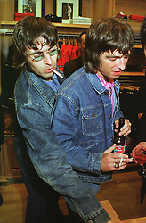 Left to right, brothers LIAM & NOEL GALLAGHER from rock group Oasis, at a party in London on 23rd February 1999.MOO 149