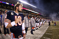 11 December 2008: Quarterback (18) Kyle Orton of the Chicago Bears listens to the National Anthem before the Bears 27-24 overtime victory over the Saints at Soldier Field in Chicago, IL.