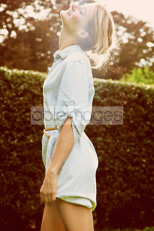 Side View of Woman in Garden Smiling