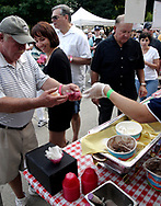 Folks gets samples from Young's Jersey Dairy during the 21st annual The Taste in the Lincoln Park Commons area at the Fraze Pavilion, Thursday, September 3, 2009.