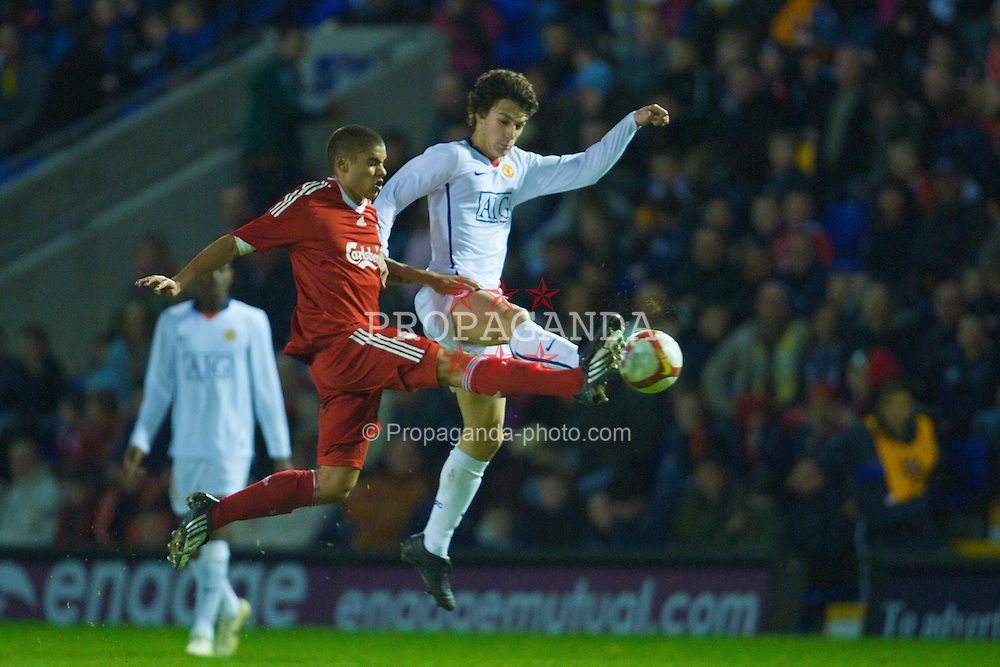 WARRINGTON, ENGLAND - Thursday, March 12, 2009: Liverpool's Victor Palsson and Manchester United's Rodrigo Possebon during the FA Premiership Reserves League (Northern Division) match at the Halliwell Jones Stadium. (Photo by David Rawcliffe/Propaganda)