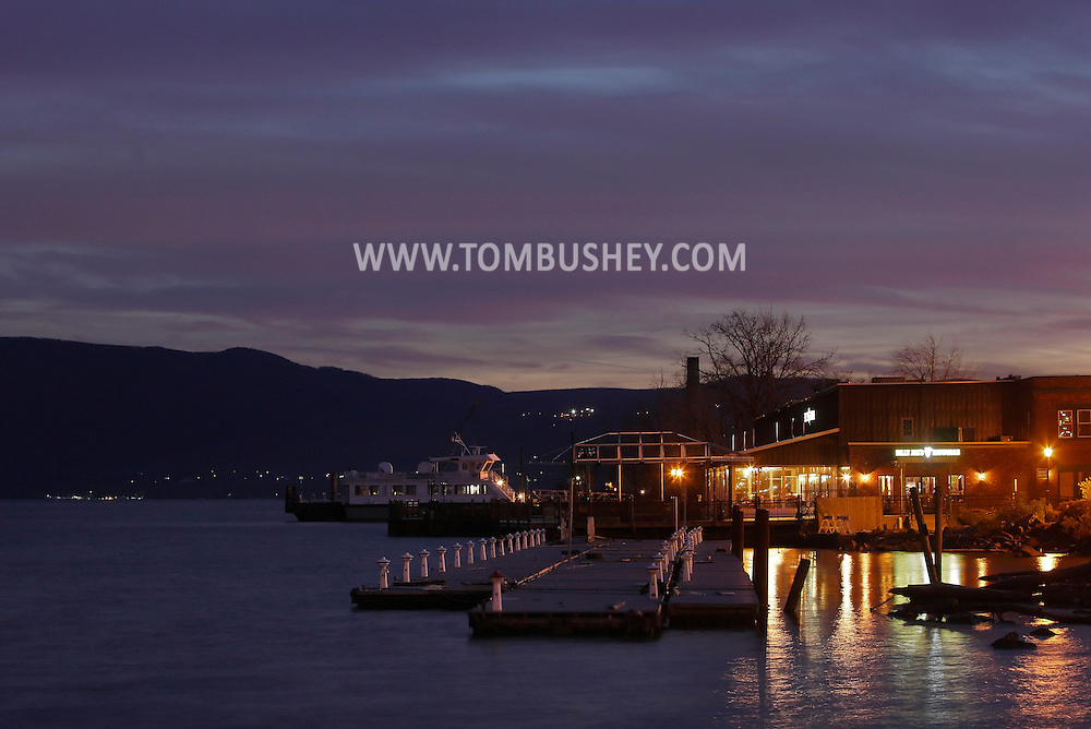 Newburgh, New York - A view of Hudson River docks and Billy Joe's Ribworks on the Newburgh waterfront at twilight on Nov. 19, 2011. The Newburgh-Beacon ferry is in the background at left.