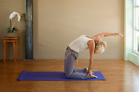 Woman in yoga pose indoors.