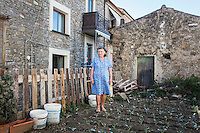 ACCIAROLI (POLLICA), ITALY - 5 OCTOBER 2016: 82-years old Fenisia La Greca poses for a portrait in her vegetable garden next to her house in Acciaroli, a hamlet in the municipality of Pollica, Italy, on October 5th 2016. Fenisia La Greca grows fruit and vegetables in her own garden.<br /> <br /> To understand how people can live longer throughout the world, researchers at University of California, San Diego School of Medicine have teamed up with colleagues at University of Rome La Sapienza to study a group of 300 citizens, all over 100 years old, living in Acciaroli (Pollica), a remote Italian village nestled between the ocean and mountains in Cilento, southern Italy.<br /> <br /> About 1-in-60 of the area's inhabitants are older than 90, according to the researchers. Such a concentration rivals that of other so-called blue zones, like Sardinia and Okinawa, which have unusually large percentages of very old people. In the 2010 census, about 1-in-163 Americans were 90 or older.