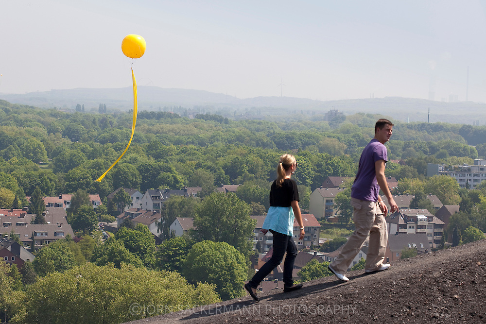 Europe, Germany, Ruhr area, Gelsenkirchen, yellow balloon of the project Schachtzeichen at the heap Rungenberg [Schachtzeichen is a project of the Capital of Culture year Ruhr2010. 311 yellow balloons with a diameter of more than three meters hovering on a steel cables in 80 meters height to mark former and still active mine shafts]...Europa, Deutschland, Ruhrgebiet, Gelsenkirchen, gelber Ballon des Projekts Schachtzeichen an der Halde Rungenberg [Schachtzeichen ist ein Projekt im Rahmen des Kulturhaupstadt Jahres Ruhr2010. 311 gelbe Balone mit einem Durchmesser von mehr als drei Metern schweben in 80 Metern Hoehe an einem Stahlseil und markieren ehemalige und noch aktive Schaechte von Bergwerken]..