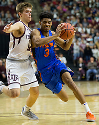 Florida guard Jalen Hudson (3) drives the lane against Texas A&M guard Chris Collins (12) during the second half of an NCAA college basketball game Tuesday, Jan. 2, 2018, in College Station, Texas. (AP Photo/Sam Craft)