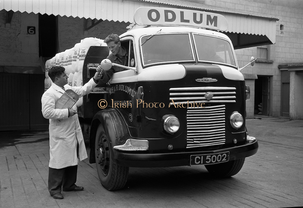 16/04/1964<br /> 04/16/1964<br /> 16 April 1964<br />  Driver Odlum's Commer flatbed lorry getting his orders at Odlum's Portlaoise, Co. Laois.