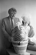 Easter Bonnet Competition.  (R54)..1987..16.04.1987..04.16.1987..As part of an Easter Promotion The Kilkenny Design Shop in Nassau Street, Dublin sponsored an Easter bonnet design competition. There follows a series of images showing some of the fabulous designs put forward. Unfortunately we do not have the caption card naming the individuals who took part, if you know any of them why not let us know at irishphotoarchive.ie and we will gladly add to the caption...An Easter Egg is the appropriate prize for the Easter Bonnet Competition.