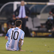 EAST RUTHERFORD, NEW JERSEY - JUNE 26:  Lionel Messi #10 of Argentina on the ground after being fouled during the Argentina Vs Chile Final match of the Copa America Centenario USA 2016 Tournament at MetLife Stadium on June 26, 2016 in East Rutherford, New Jersey. (Photo by Tim Clayton/Corbis via Getty Images)