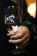 A wine taster holds a glass during a special preview of Running Wild, a documentary on the life of wild horse rescuer Dayton O. Hyde, at Big Dog Vineyards in Milpitas, California, on March 8, 2013. (Stan Olszewski/SOSKIphoto)