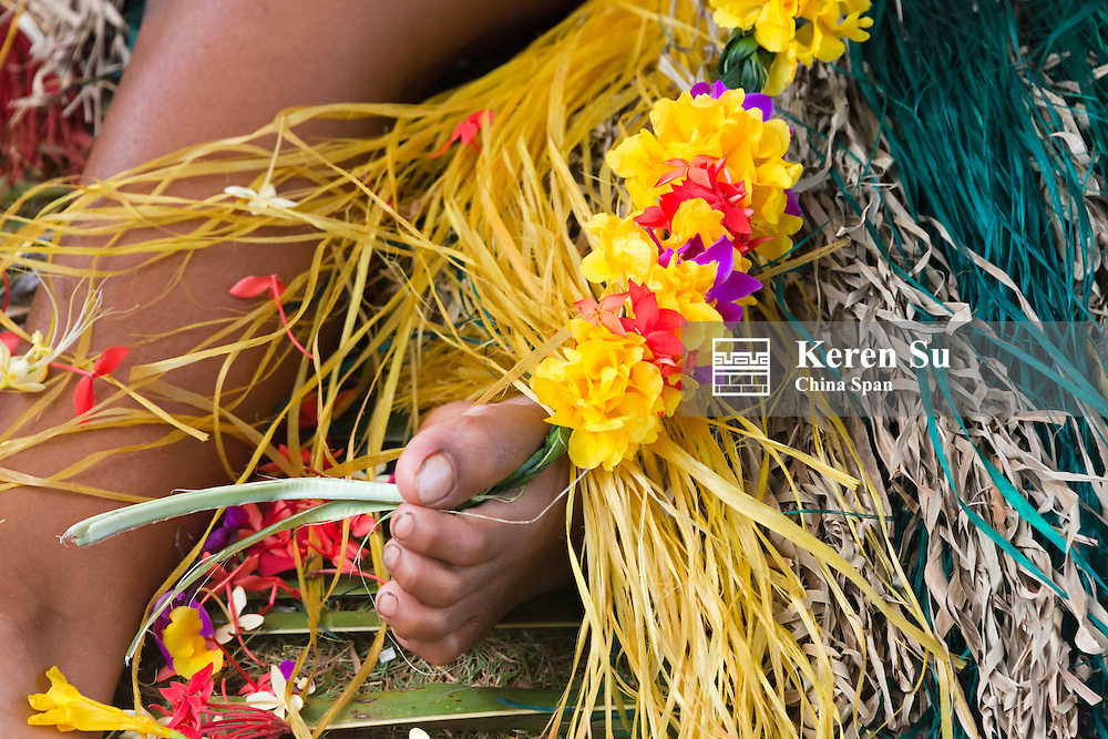 Yapese girl making flower lei for Yap Day Festival, Yap Island, Federated States of Micronesia
