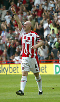 Fotball<br /> Nationwide First League England<br /> 23.08.2003<br /> Foto: Digitalsport<br /> Norway Only<br /> <br /> Photo. Andrew Unwin<br /> Sheffield United v Norwich, Nationwide League Division One, Bramall Lane, Sheffield 24/08/2003.<br /> Sheffield United's Robert Page salutes the crowd after scoring the first goal of the match.