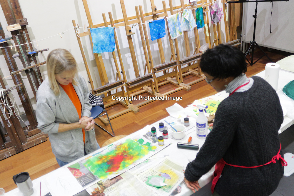 """Instructor September Krueger, right, talks to Mary Bryan during """"Create Your Own Quilt Squares"""" Sunday November 23, 2014 at the Cameron Art Museum in Wilmington, N.C. (Jason A. Frizzelle)"""